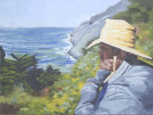 man contemplating by the ocean